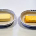 Margarine vs. Butter.  Always choose butter over margarine. It's real and if not over eaten can be beneficial for fat intake. Margarine has added Hydrogens and has been known to cause certain health issues