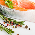 {Raw salmon steak with rosemary}